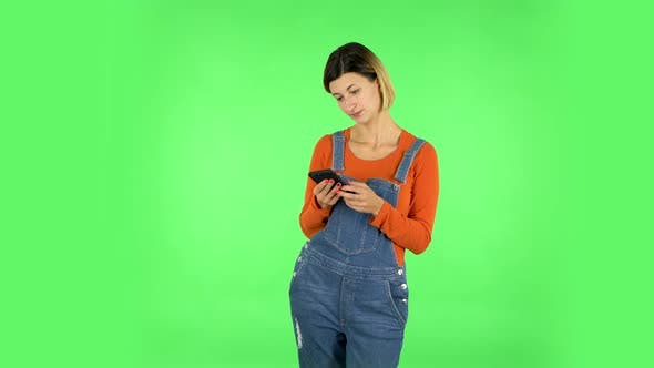 Thumbnail for Woman Texting on Her Phone. Green Screen