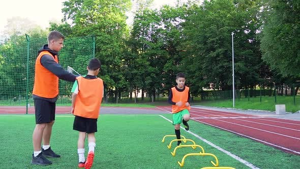 Thumbnail for Football Trainer Giving High Five to His Pupils After they Finished to do Running Exercises