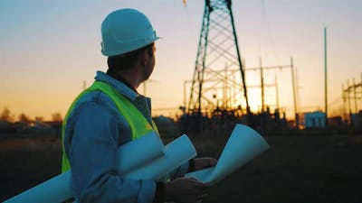 Architect Worker Checking Construction Project On Electric Tower