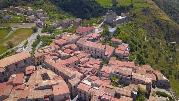 Thumbnail for Aerial View of Medieval City on Hill Overlooking the Sea Coast Village and Mountains, Sunny Day