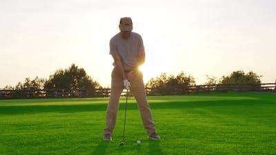 Handsome Older Golfer Swinging Golf Club, Golfing in Paradise