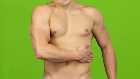 Thumbnail for Muscular Man Make Massage on Left Side. Green Screen, Closeup