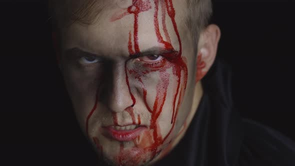 Thumbnail for Halloween Man Portrait. Guy with Dripping Blood on His Face. Scary Makeup