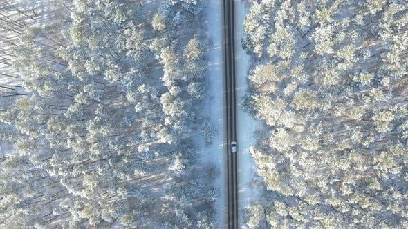 Thumbnail for White Car Riding Through Snowy Rural Road