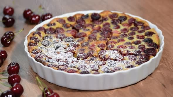 Thumbnail for Cherry Clafoutis with powdered sugar in baking dishes