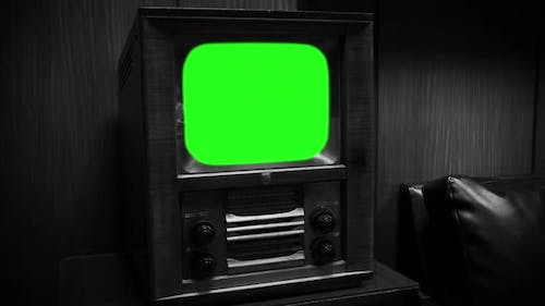 Old Television Set with Green Screen. Aesthetics from the 50s or 60s. Black and White Tone. Zoom In.