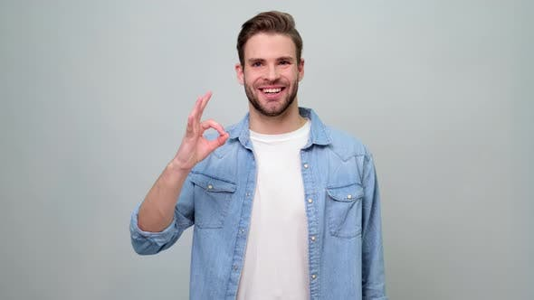 Thumbnail for smiling young caucasian man showing ok sign