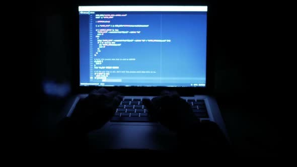 Thumbnail for Programmer Typing Code On Computer At Night