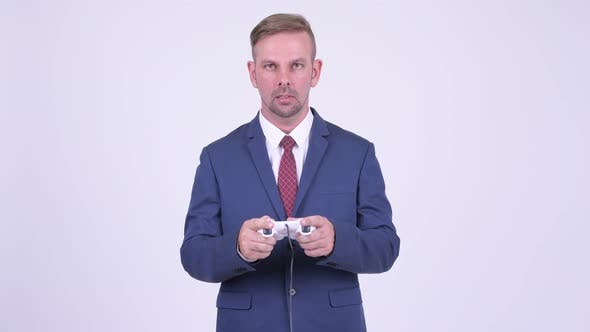 Thumbnail for Stressed Blonde Businessman Playing Games and Losing