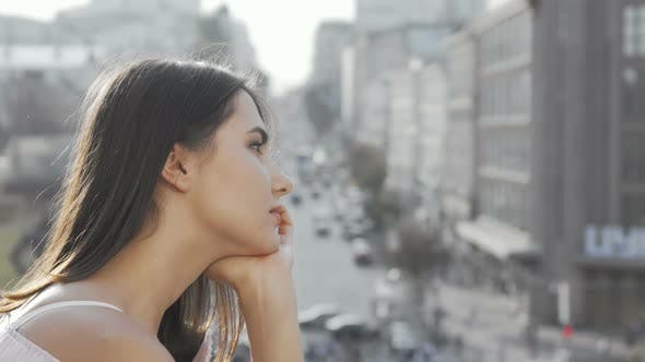 Thumbnail for Sad Woman Looking Away at Blurry City Streets