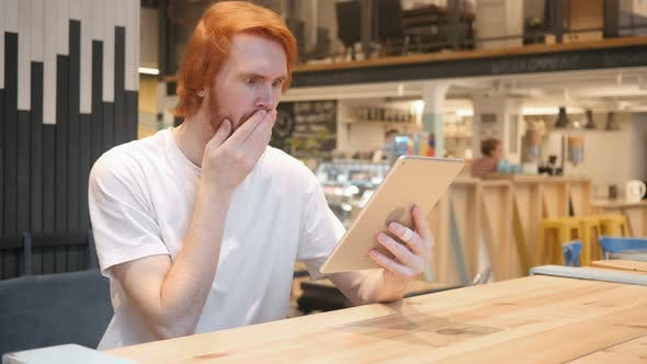 Thumbnail for Shocked, Wondering Redhead Beard Man Using Tablet PC in Cafe
