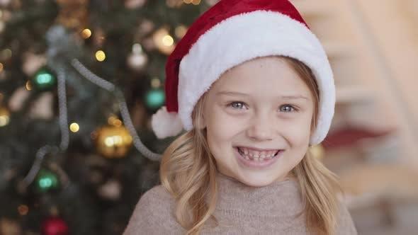 Grade Schooler in Santa Hat Smiling