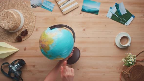 Rotating Globe And Pointing At Destination