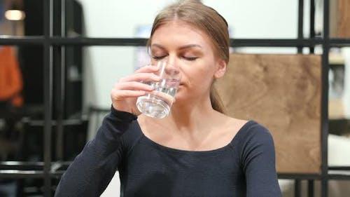 Girl Drinking Water, Office Portrait