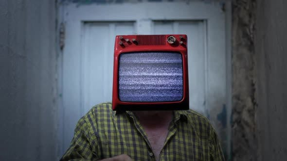 TV with Static Noise on the Head of a Man. TV Addiction Concept.