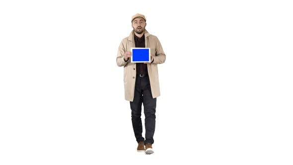 Thumbnail for Young man walking talking and showing digital tablet with