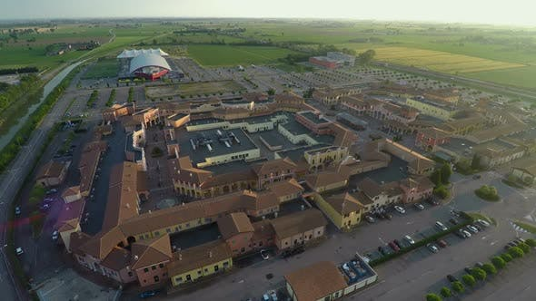 Cover Image for Aerial view of Mantova outlet village, shopping tour to Italy, brands and trends