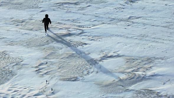 Human Walk Throw the Snowfield.