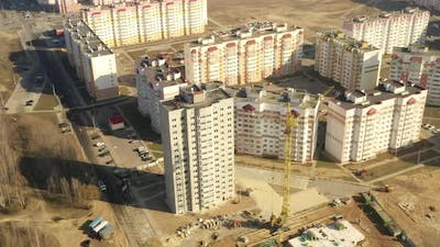 Construction Crane Is Involved In Construction Of A New Multistorey Residential Houses