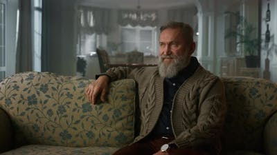 Handsome Old Man Sitting Couch in Luxury House