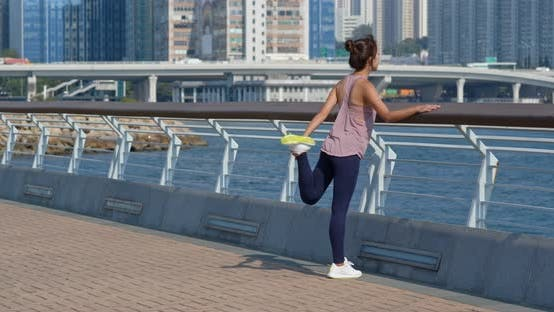 Thumbnail for Woman stretch legs before running at outdoor
