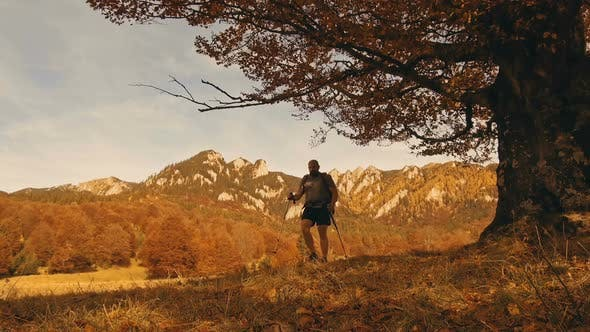 Thumbnail for Man Hiking at Sunset in Mountains