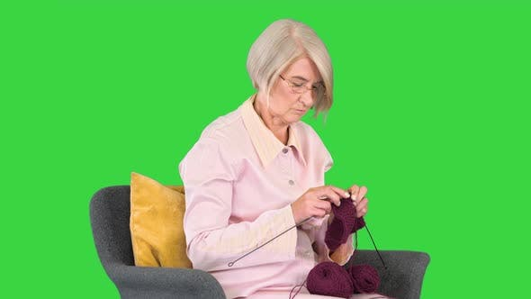 Thumbnail for Elderly Woman Knitting Sitting on a Chair on a Green Screen Chroma Key