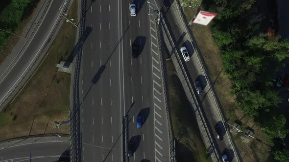 Thumbnail for Car Driving on Road Interchange. Drone View Car Traffic on on Highway Bridge