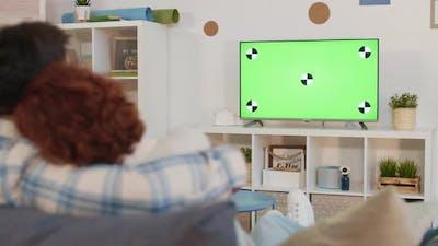 Romantic Couple Watching Green-screened TV