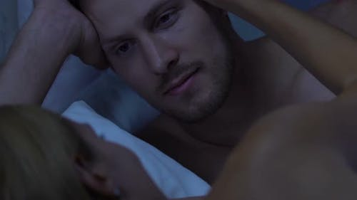 Woman Gently Stroking Man in Bed, Admiring His Masculinity, Intimate Relations