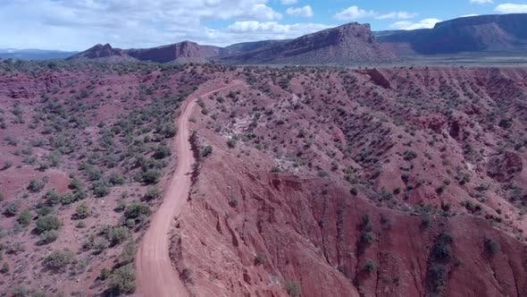 Aerial drone view of scenic red rock landscape in Moab, Utah.