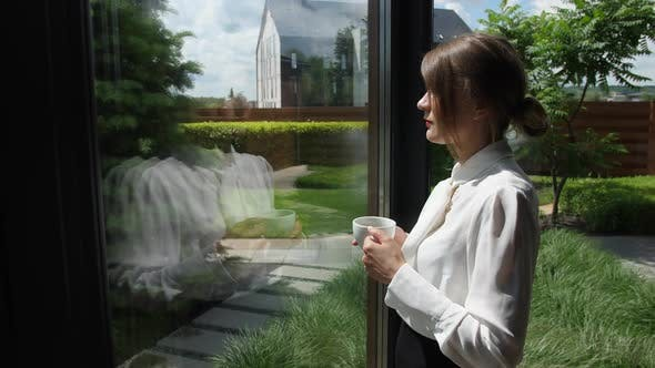 Thumbnail for Woman Drinking Coffee Enjoying View From Window