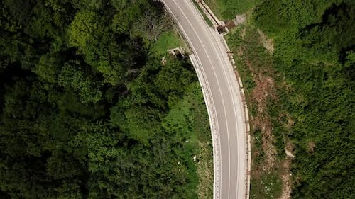 Aerial View From Drone of Curve Road with a Car on the Mountain with Green Forest in Russia