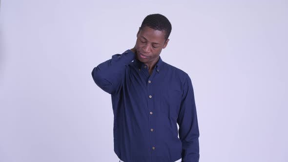Cover Image for Young Stressed African Businessman Having Neck Pain