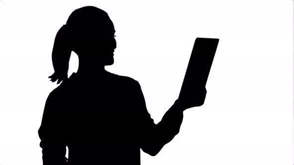 Thumbnail for Silhouette Positive Businesswoman Is Talking on the Skype with Partners on Tablet