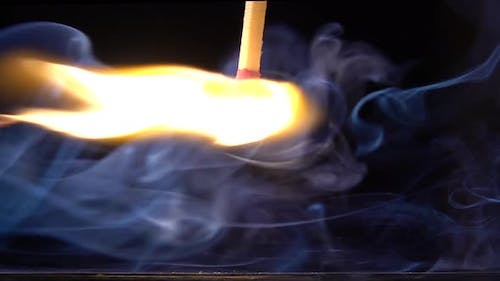 A Matchstick Lights After It Is Struck Against the Striking Surface of a Match Box. Slow Motion