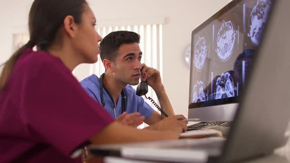 Thumbnail for Mexican doctors analyzing brain x-rays