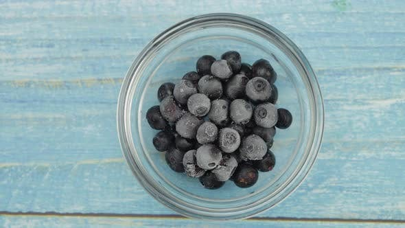 Thumbnail for Timelapse Footage of Freezing Fruits, Berries on the Glass Plate. Frozen Food. Frosting of Blueberry