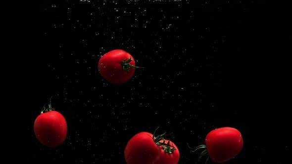 Thumbnail for Red Ripe Tomatoes Splash In Water With Air Bubbles And Droplets