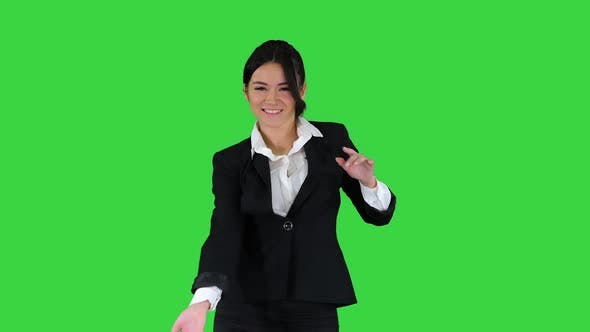Thumbnail for Beautiful Businesswoman Inviting You To Dance with Her on a Green Screen, Chroma Key
