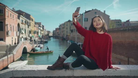 Thumbnail for Asian Woman in Venice, Taking Self-portrait Photo on Vacation Travel in Italy. Smiling Happy Mixed