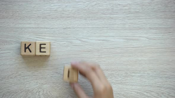 Cover Image for Keep Calm, Hand Putting Words on Wooden Cubes, Positive Thinking and Motivation