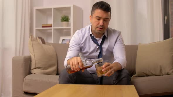 Thumbnail for Alcoholic with Bottle Drinking Whiskey at Home