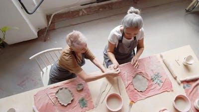 Two Female Ceramists Working in Art Studio