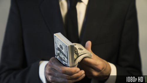 Businessman Holding and Counting American $100 Dollar Banknotes for Money and Financial Concept