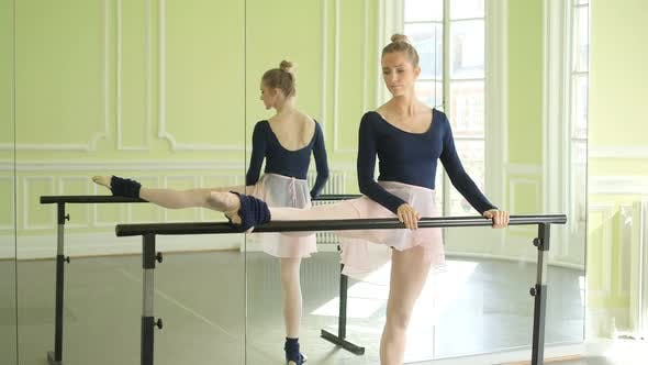 Thumbnail for Female Ballet Dancer stretches and practices using the barre