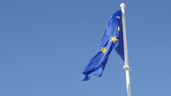 European Union recognizable flag waving in front of blue sky 4K 2160p 30fps UHD footage - Flag of Eu