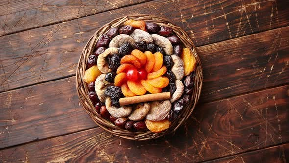 Thumbnail for Mix of Dried Fruits in a Small Wicker Basket on Wooden Table
