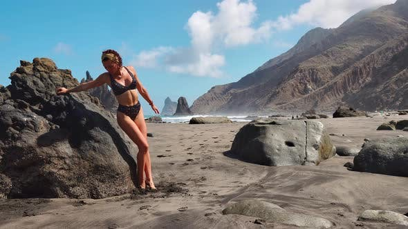Thumbnail for Young Woman in Bodysuit Practicing Yoga on the Beach Above Sea at Amazing Sunrise. Fitness, Sport