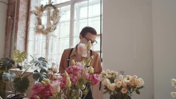 Thumbnail for Young Man in Apron Using Digital Tablet during Workday in Flower Shop